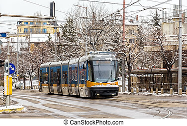 Modern tram on a street of Sofia - Bulgaria