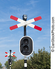 railroad crossing sign with warning lights