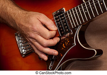 guitar solo - closeup of guitarists hand during a live...