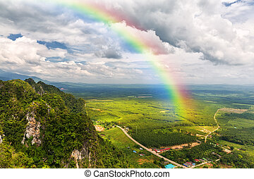 Beautiful landscape with a rainbow in the sky
