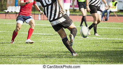 Rugby player kicking the ball - Rugby player kicking hard...