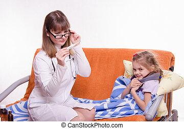 Pediatrician checks temperature on electronic thermometer sick child