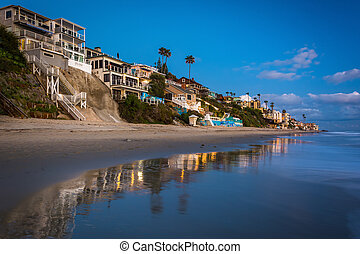 Beachfront homes at twilight, in Laguna Beach, California.