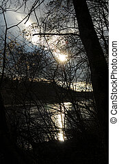 Nature 072 - Sun over a river at heavy wheather.