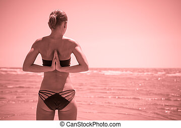 Woman doing yoga reverse namaste - Woman doing yoga asana...