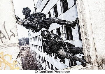 tactical rappeling - Spec ops police officers SWAT during...