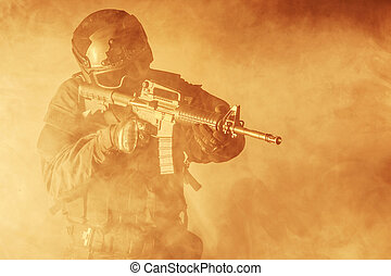 Spec ops police officer SWAT in the smoke and fire
