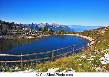 Small lake in the mountains - Swiss Alps. A small lake in...