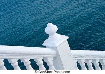 Balustrade - White balustrade with ocean blue background,...