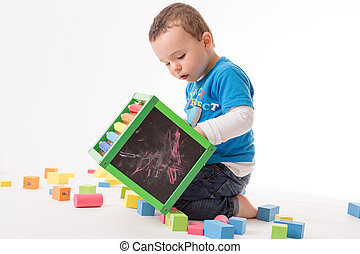 Playing small boy - Small boy is playing with colorful cubes