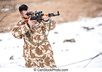 Military army trooper, ranger firing and shooting with gun