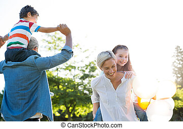 Happy family playing at the park