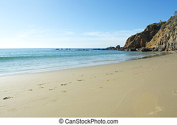 Sandy beach - A wide scenic panorama of gently flowing ocean...