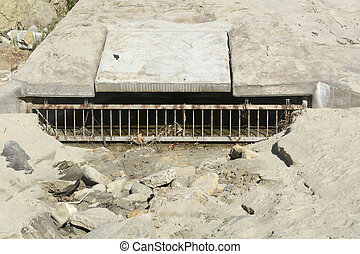 Beach sewer - A beach sewer used to drain water runoff from...