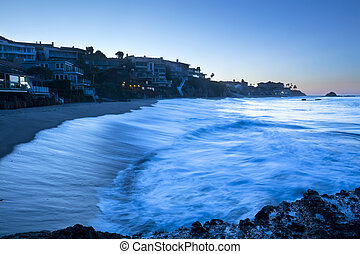 Wave breaking in cove - A wave lit by the bright moonlight...