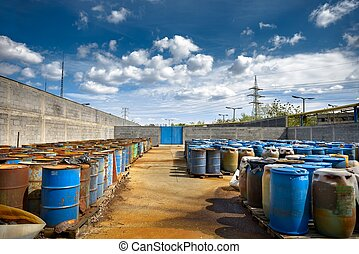 Several barrels of toxic waste at the dump