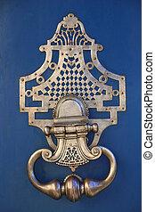 Knocker - Bronze knocker on an old wooden door
