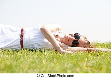women lie down on grass,Outdoor at park