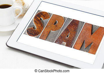 spam word on a digital tablet - spam word (unsolicited and...