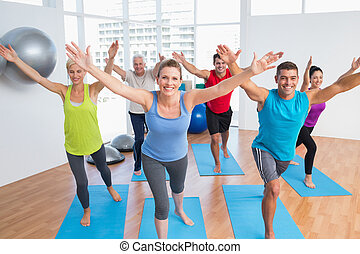 People exercising in gym class - Portrait of happy fit men...
