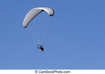 Paraglider - Paragliding high above the ground. Propellar...