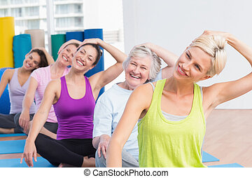 Women doing neck exercise at fitness club - Happy women...