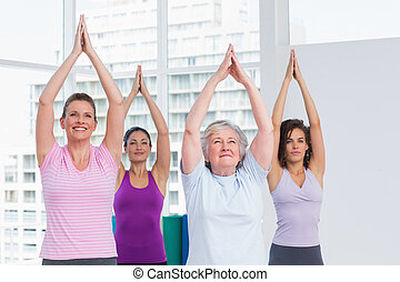 Friend with hands clasped exercising in gym - Female friend...