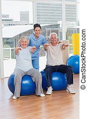 Senior couple on exercis ball - Portrait of senior couple on...
