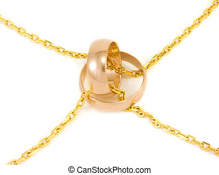 Golden wedding rings with a chain on white background