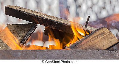 Firewood heating up in the grill. background