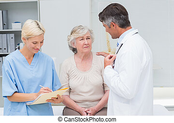 Doctor consoling patient - Male doctor consoling patient...