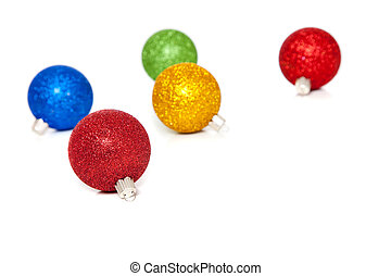 Glittery Christmas ornaments on white