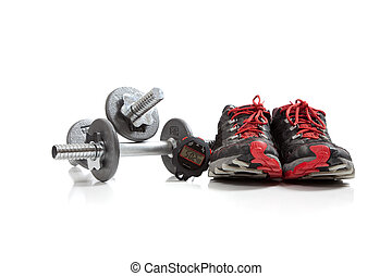 Dumbbells and tennis shoes on a white background
