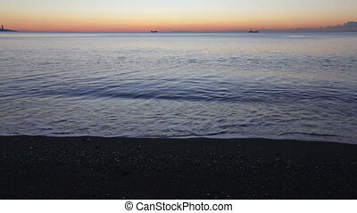 Sunrise view of Mediterranean sea and sand beach