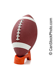 American Football on a kicking tee - An american football on...