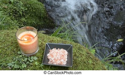 Candle and salt at riverside - Glass candle and himalayan...