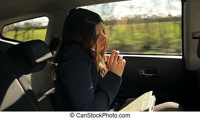 business woman on the phone in taxi
