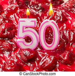 Cherry cheese cake with candles for 50th birthday - Cherry...