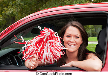 Female Student with Pom Pom - Female student sitting in car...