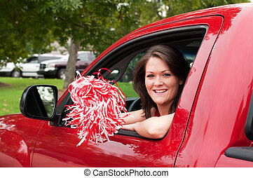 Girl Sitting in Truck with Pom Pom - Girl sitting in truck...