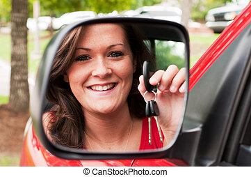 Attractive Brunette Holding Keys in Vehicle Mirror -...