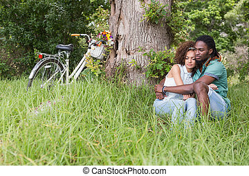 Young couple on a picnic eating wa - Young couple on a...