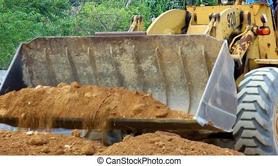 Earthmover dozer doing earthmoving works outdoors