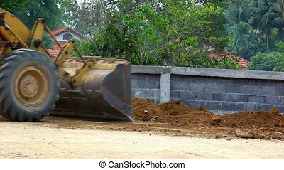 Earthmover dozer doing earthmoving works outdoors.