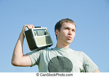 man with old radio receiver