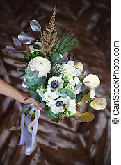 Wedding bouquet with ranunculus, freesia, roses and white...