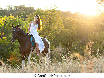 Beautiful woman and a horse Summer time