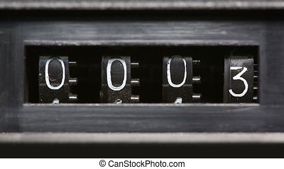old mechanical counter counts numbers - macro