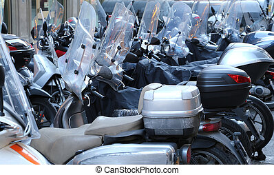 scooters and mopeds with winter windshield parked