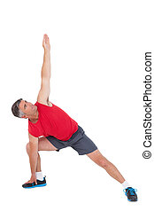 Fit man stretching his legs and arms